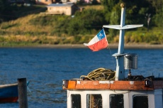 A fishing boat flies the Chile flag