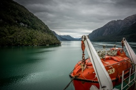 Meandering through a narrow fiord to see a glacier